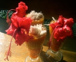 Tropical fruit smoothie with coconut, edible hibiscus flower