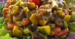 Tangy sweet and sour dressing on veggie stew