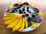 Masterpiece green spoothie with wild berries, dragonfruit, mango